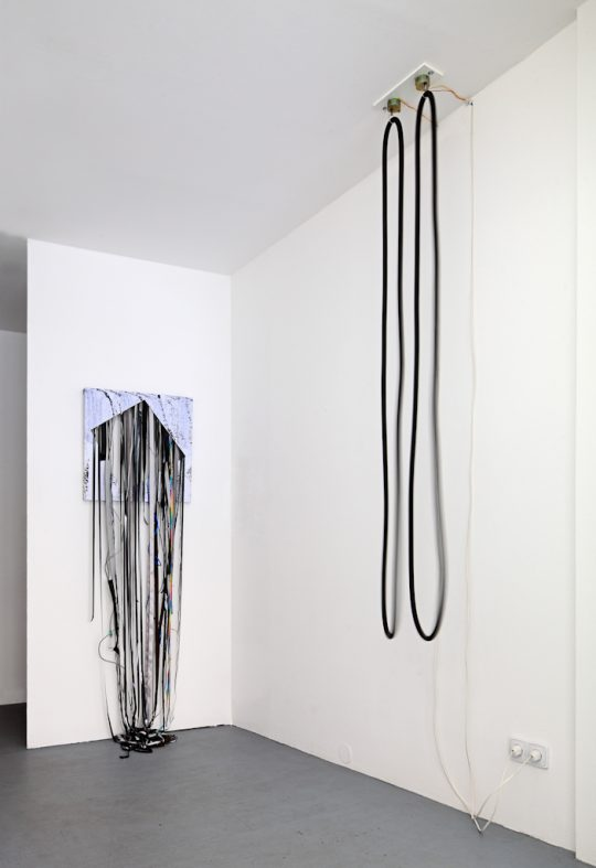 (left side) <br>Mixed Media\nUnique \n195 x 60,5 x 32 cm \n\n(right side)\n2 motors, 2 rubber loops \nUnique \n220 x 50 x 50 cm\n\nPhoto: Cordia Schlegelmilch, courtesy Galerie Gilla Loercher