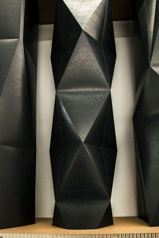 Installation\r<br>24 Unique objects in a shelf with 3 compartments\r\nPressboard, metal\r\nInstallation: 313 x 211 x 24 cm \r\n\r\nPhoto: Ute Schendel, courtesy Galerie Gilla Loercher